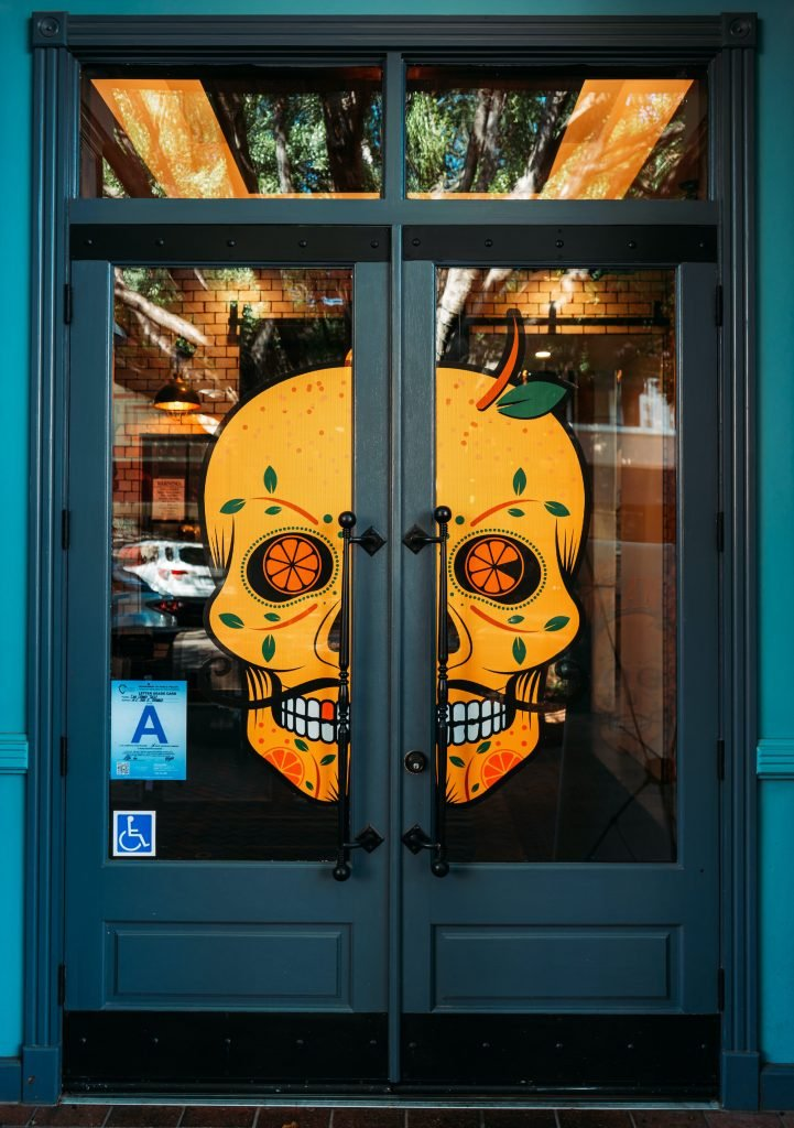 Don Orange Front Door with Orange Skull Logo